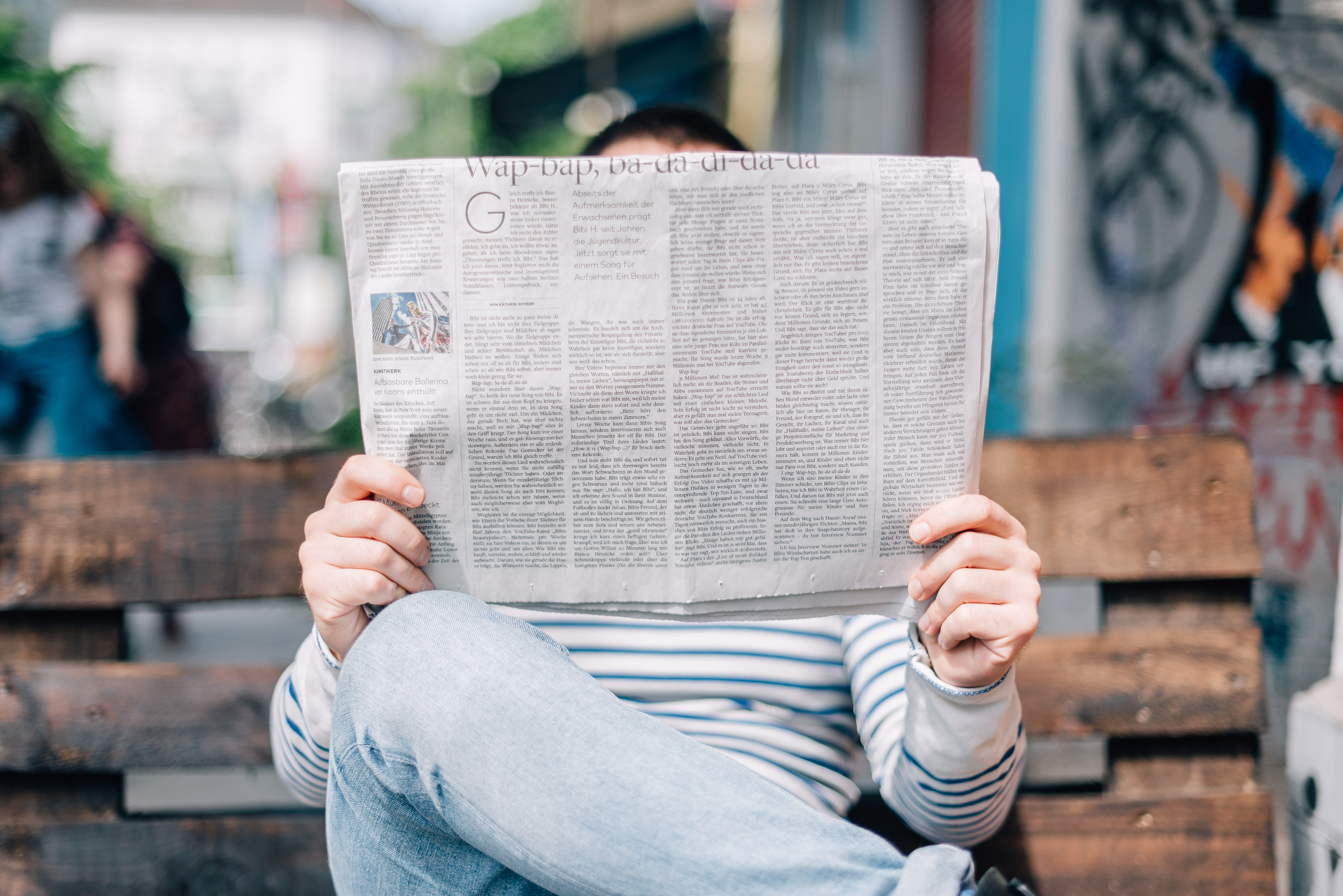 Photo of a man reading the newspaper by Roman Kraft on Unsplash